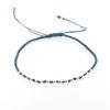 Billede af Classic by Pind Colorful ,knyttet armbånd demin blå med sølv kugler
